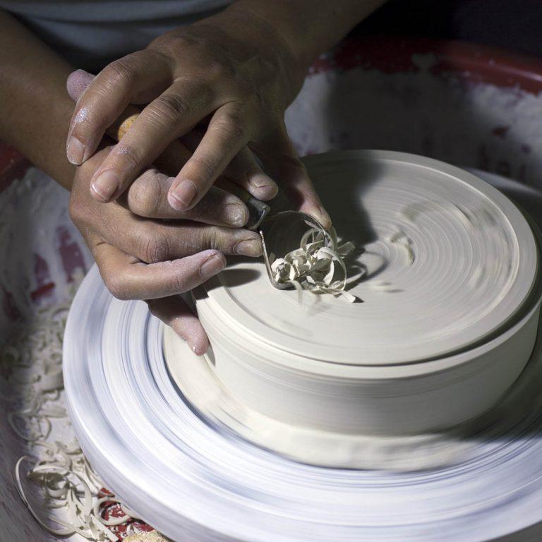deft hands shape a ceramic vessel on the wheel