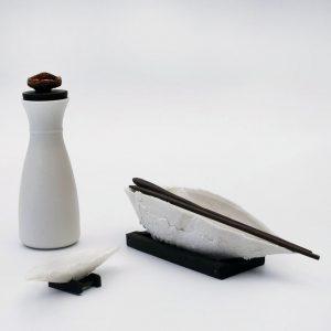 Porcelain Carafe and cast vessels